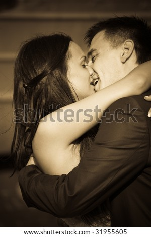 New husband and wife kissing in romantic hug - stock photo