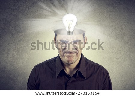 New idea bulb,Portrait of Young man thinking too hard for new idea from head. - stock photo
