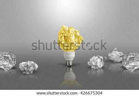 New idea concept with black and white background and reflections crumpled office paper and light bulb - stock photo