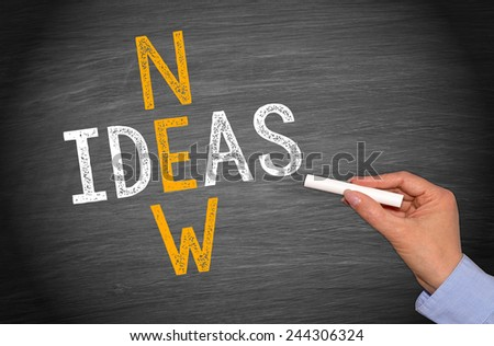 New Ideas - blackboard with female hand and chalk - stock photo