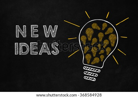 New ideas concept with a big light bulb isolated on blackboard. A big light bulb which contains a lot of smaller yellow light bulb. Cooperation generates new ideas  - stock photo