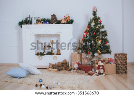 New interior with Christmas tree, presents and fireplace