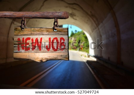 New job motivational phrase sign on old wood with blurred background