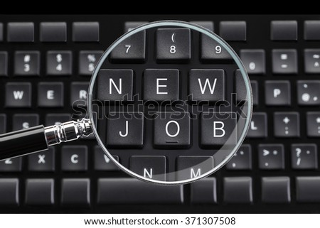 NEW JOB written on keyboard with magnifying glass