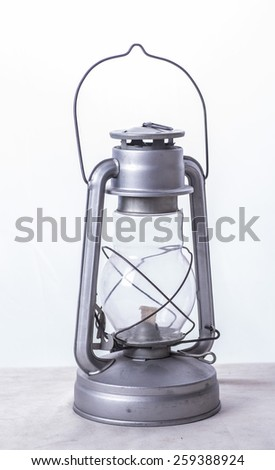 new kerosene lamp on a white background - stock photo