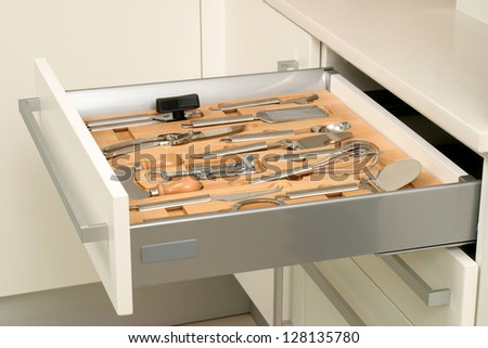 new kitchen drawer with utensils - stock photo