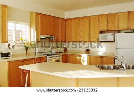 New Kitchen with Maple Cabinets - stock photo
