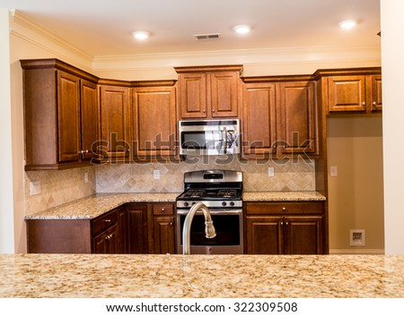 New kitchen with modern fixtures - stock photo