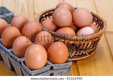 new-laid eggs Chicken egg of brown color in cardboard cells