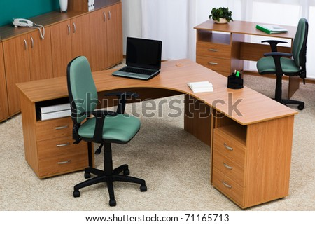 New laptop on a desk at modern office - stock photo