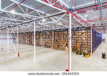 New Large modern storehouse with some goods - stock photo