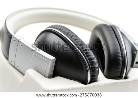 New leather headphones close-up in a box. Isolate on white. - stock photo
