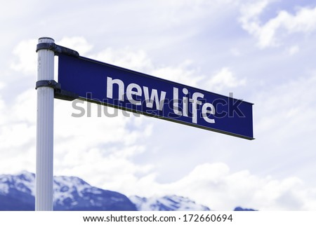 New Life creative sign with mountains and clouds as the background - stock photo