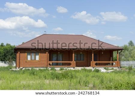 New log house on the uninhabited area. - stock photo