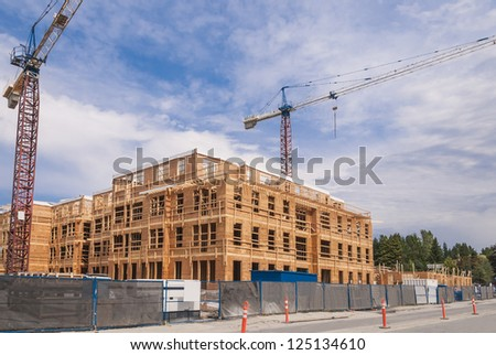 New low-rise apartments building construction - stock photo