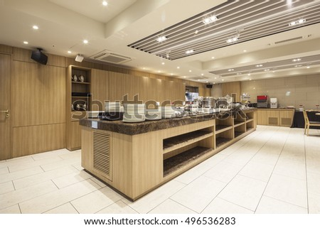 New luxury boutique hotel restaurant, buffet with wood table, chair, dish in seoul, south korea.