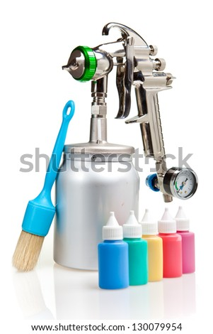 New metal brilliant Spray gun and small bottles with color - stock photo
