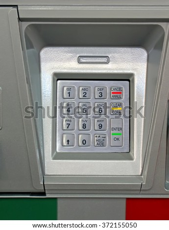 new metallic dial keypad closeup on bank device, numbers diversity - stock photo