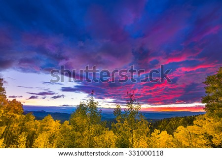 New Mexico fall mountain sunset  featuring golden aspens and colorful clouds - stock photo