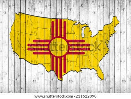 New Mexico flag with America map and wood background - stock photo