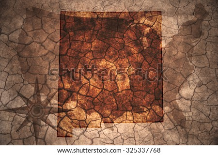 New Mexico state map on vintage usa map, crack paper background - stock photo