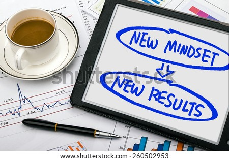 new mindset new results concept handwritten on tablet pc