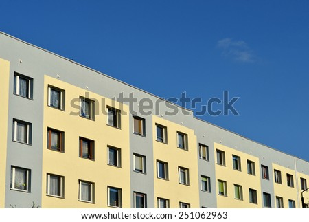 New modern apartments town building on blue sky