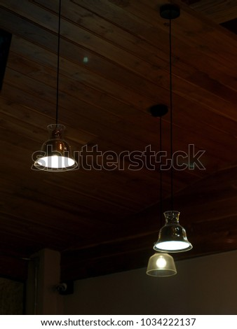 new modern clean style home decoration ceiling lamps hanging inside a warm tone wooden house selective focus with authentic blur background