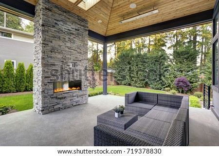 New Modern Home Features A Backyard With Covered Patio Accented With Stone  Fireplace, Vaulted Ceiling