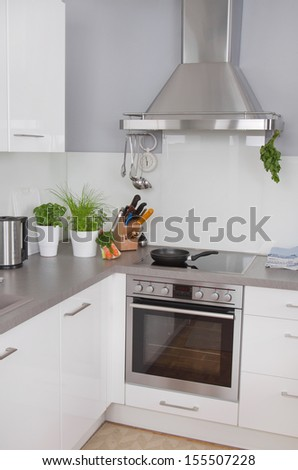 New modern kitchen with stainless steel appliances - stock photo
