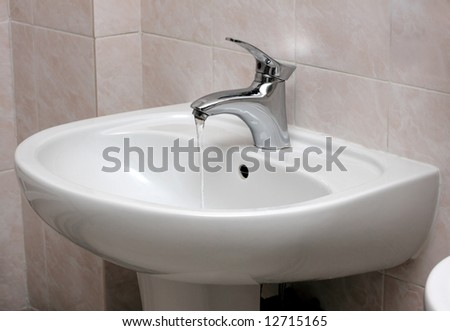 New modern water faucet and basin - stock photo
