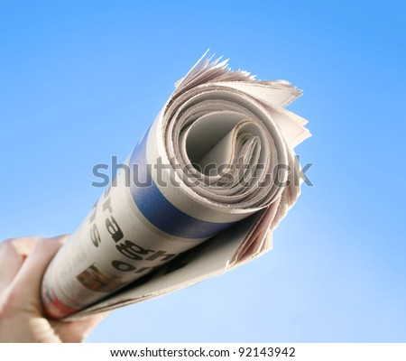 New News With A Hand Holding A Newspaper About To Be Delivered - stock photo