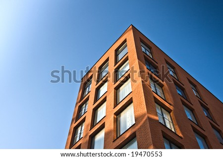 New office building with blue sky. Horizontal background. - stock photo