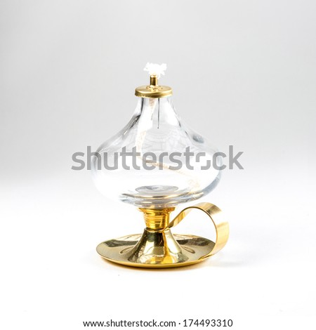 new oil lamp on white background - stock photo