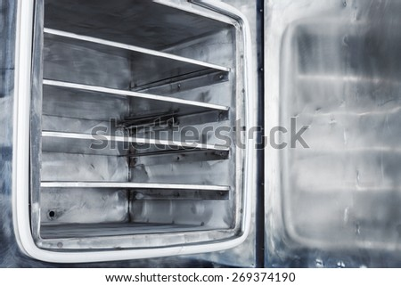 new open vacuum furnace close up - stock photo