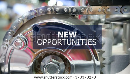 NEW OPPORTUNITIES on the Mechanism of Metal Cogwheels background , color filter image , innovation concept , business concept, business idea - stock photo