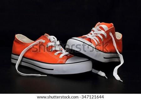 new orange sneakers - stock photo