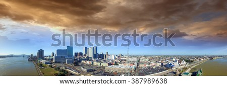 New Orleans at dusk. Aerial panoramic view of city and river. - stock photo