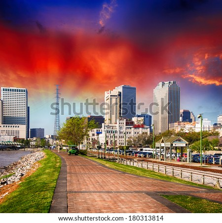 New Orleans at sunset. Spectacular view of riverwalk with city buildings. - stock photo