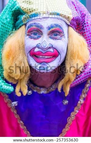 NEW ORLEANS-JUL 14: Street performer dressed as Madri Gras Clown on JUL 14, 2011. The city has up to ten million visitors annually. - stock photo