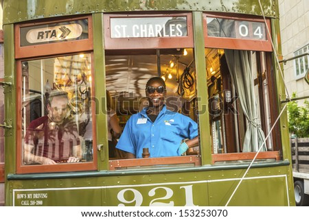 NEW ORLEANS - JULY 17: friendly conductor in the  famous old Street car St. Charles line on July 17, 2013 in New Orleans, USA.  It is the oldest continually operating street car line in the world. - stock photo