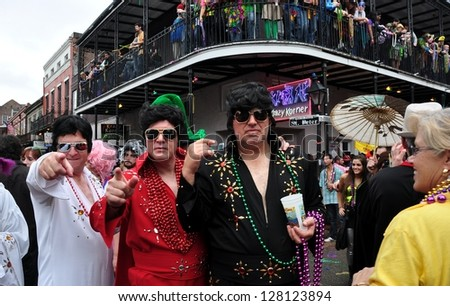 NEW ORLEANS, LA - FEBRUARY 12:  Three Elvis impersonators celebrate in the New Orleans French Quarter on Mardi Gras Day, February 12, 2013. - stock photo