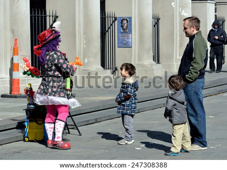 NEW ORLEANS, LA-JAN. 24:  A balloon clown entertains visitors to Jackson Square in the New Orleans French Quarter on January 24, 2015. - stock photo