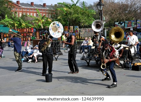 NEW ORLEANS, LA-JAN. 12: A local jazz band performs in front of Jackson Square in the New Orleans French Quarter on January 12, 2013, to the delight of visitors in town for Superbowl XLVII. - stock photo