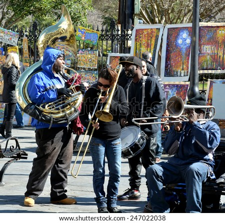 NEW ORLEANS, LA-JAN.24: A local jazz band performs in front of Jackson Square in the New Orleans French Quarter on January 24, 2015, to the delight of visitors in town for Mardi Gras. - stock photo