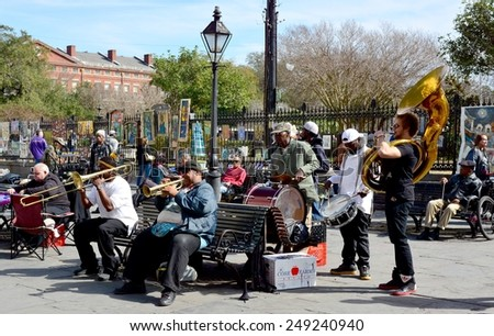 NEW ORLEANS, LA-JAN.31: A local jazz band performs in front of Jackson Square in the New Orleans French Quarter on January 31, 2015, to the delight of visitors in town for Mardi Gras. - stock photo