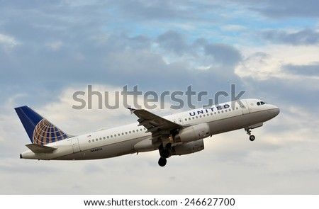 NEW ORLEANS, LA-JAN 22: a United Airlines Commercial Passenger Jet departs New Orleans International Airport on January 22, 2015.  - stock photo