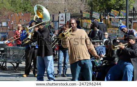 NEW ORLEANS, LA.-JANUARY 24: A local jazz band performs in front of Jackson Square in the New Orleans French Quarter on January 24, 2015, to the delight of visitors in town for Mardi Gras.  - stock photo