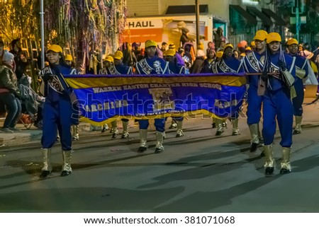 New Orleans, LA/USA - circa February 2016: School kids go in parade during Mardi Gras in New Orleans, Louisiana - stock photo