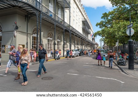 NEW ORLEANS, LOUISIANA - APRIL 10, 2016: Bourbon Street in New Orleans with People During the French Quarter Festival - stock photo